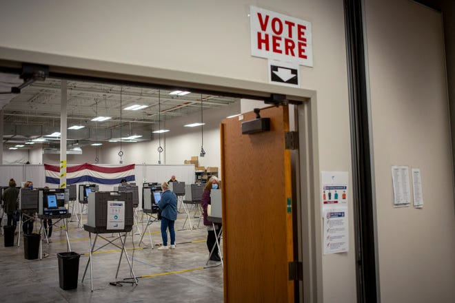 Voters in Delaware County cast their ballot during early voting at the Board of Elections on the north side of Delaware, Ohio on Tuesday, Oct. 27, 2020.