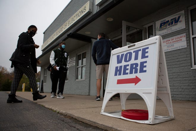 Voters in Delaware County arrive to cast their ballot during early voting at the Board of Elections on the north side of Delaware Tuesday.