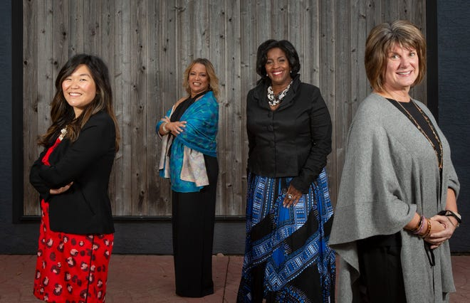 From left: Sachiyo Isoda Peterson, a partner at Vorys, Sater, Seymour and Pease LLP; Sandra Lopez, a legislative adviser to Columbus City Council; Kim Carter, campus dean at Strayer University; and Tara Bair, president and CEO of Community Health & Wellness Partners, are being recognized by Women for Economic and Leadership Development.