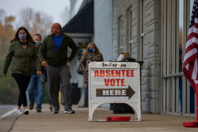 Voters in Delaware County arrive to cast their ballot during early voting at the Board of Elections on the north side of Delaware, Ohio on Tuesday, Oct. 27, 2020.