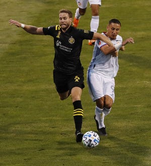 Crew defender Josh Williams, left, will miss Wednesday night's game at D.C. United as well as a game on Sunday after being suspended by Major League Soccer.