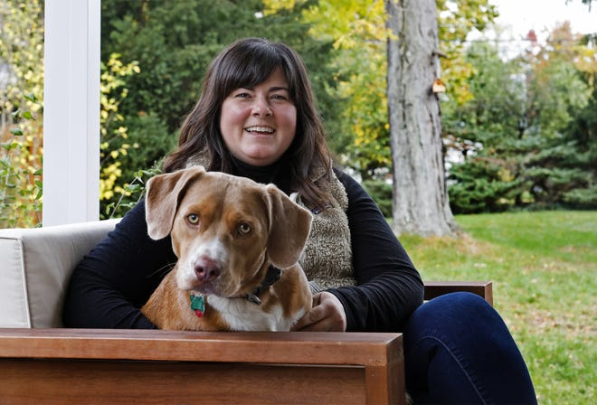 Lindsay Buchanan of Clintonville took in Eddie, a beagle mix, in March, and he has been a source of comfort as the coronavirus pandemic has stretched on and on.