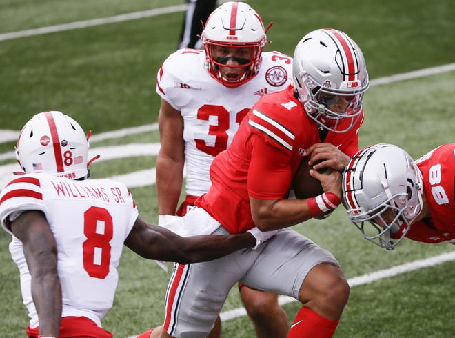 Ohio State quarterback Justin Fields runs against Nebraska on Saturday. His 15 carries were the second most of his college career.
