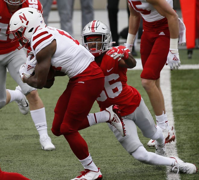 Ohio State's Chris Booker tackles Nebraska's Rahmir Johnson on a kickoff return during the fourth quarter Saturday.