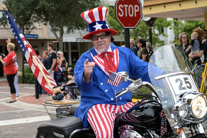 A man poses as Uncle Sam at the Vet Fest Parade in downtown Eustis last year. This year's Vet Fest Parade steps off at 4 p.m. Sunday at the Eustis Armory, 605 S. Bay St., and ends at Ferran Park.