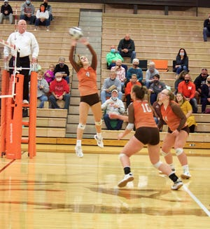 Meadowbrook's Ella Jefferis (4) sends the ball over the net during Tuesday's Division II district semi-final victory over Claymont at Meadowbrook High School.