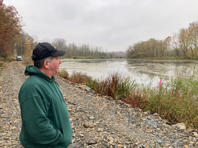 Killbuck Marsh Wildlife Area manager Dennis Solon talks about the Big Spring project. Behind him out of the hill flows 4,500 gallons of water an hour into the pond in front of him.