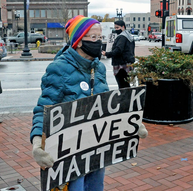 Wooster resident Linda Houston holds her Black Lives Matter sign at the Wednesday protest downtown.