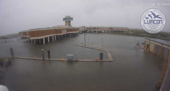 Water rises around 1 this afternoon at LUMCON, about 10 miles inland from the Gulf of Mexico in southern Terrebonne Parish.