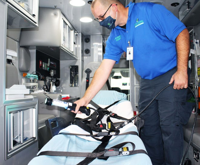 Emergency Medical Technician (EMT) James Bumpus uses one of the new UV lights in the back of a Maury Regional ambulance.