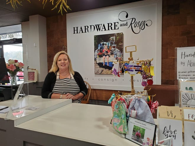 Arianna Lester, owner of the Hardware and Roses store which opened in Lexington in July, has built her business mission around her personal philosophy of finding uses for older items and using her creative skills to upcycle those items to be attractive and stylish. She even practices upcycling in the design of her store and its display fixtures. For example, the wooden wall behind her checkout area is made from wood that was once a storage bin at her family's store, Lanier Ace Hardware.