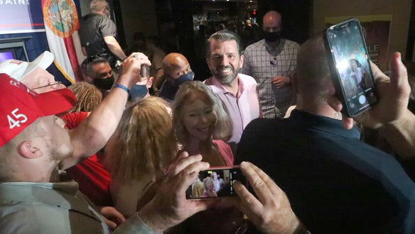 Donald Trump Jr. visits with a crowd following his speech, Wednesday, October 28, 2020 during a campaign stop for his father, President Donald Trump, at Volusia Top Gun in Daytona Beach.