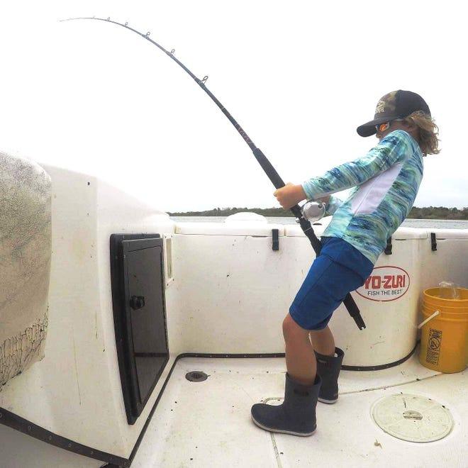 Kurt Bishop, 6, battles a bull redfish in Ponce Inlet.