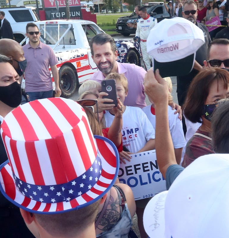 Donald Trump Jr. takes a photograph with some young fans Wednesday, October 28, 2020 during a campaign stop for his father, President Donald Trump, at Volusia Top Gun in Daytona Beach.