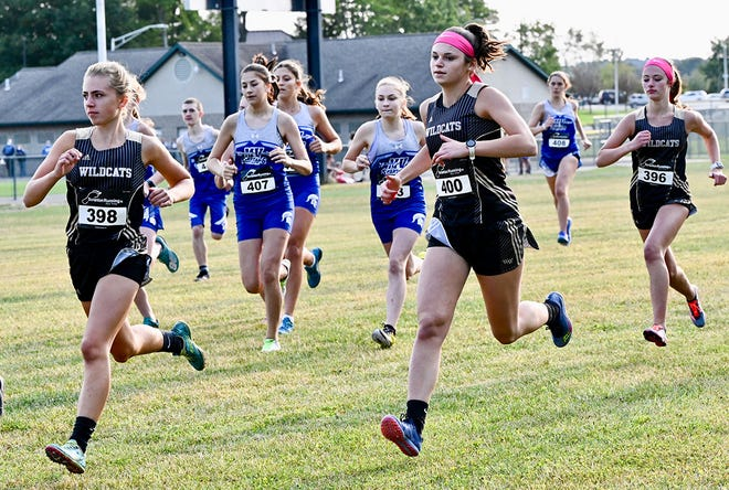 Lady 'Cat runners rocket off the starting line during recent Lackawanna League varsity cross country action. The Lady 'Cats posted a 5-2 record this fall and are looking to make some noise at the Class AA district race. Pictured are (from left): Haley Estus, Sydney Hutchinson and Jamie Bryan.