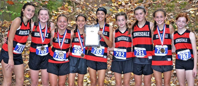 Honesdale's girls junior high cross country team closed out an undefeated season by finishing first at the Vince Fedor Championships. This year's edition of the race was held Saturday at Dunmore. Pictured are (from left): Erin Meagher, Emilia Williams, Lily Taraschuk, Olivia Pinto, Zoe Hall, Meghan Dowling,  Cassidy Castrovillari, Megan Kretschmer, Madison Shafer.