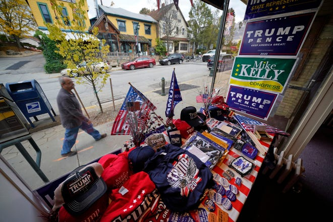 A man walks past the window display of the Butler County Republican Committee office in Slippery Rock on Oct. 15. It's one of three campaign offices in Butler County, where there are nearly two Republicans for each registered Democrat. (AP Photo/Gene J. Puskar)
