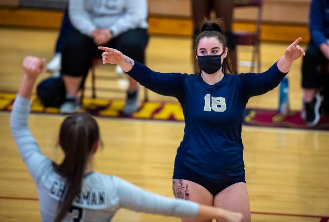 William Chrisman libero Patience Farmer (18) celebrates a point with teammate Courtney Taylor, front, in their Class 4 District 15 semifinal match against Winnetonka. The Bears claimed a win in the third set but fell 3-1 to the host Griffins to end their season.