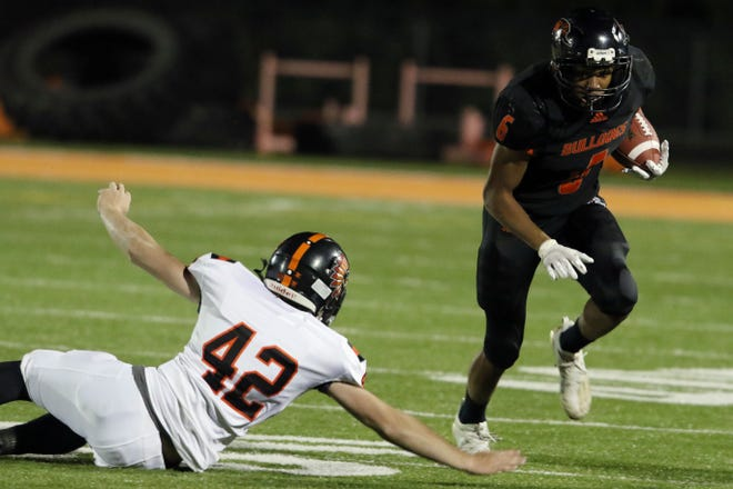 Mediapolis High School's Anthony Isley (6) on his way to scoring during the first half of their game against Van Buren High School Oct. 16 at Mediapolis. Mediapolis went into halftime with a 54-0 lead.