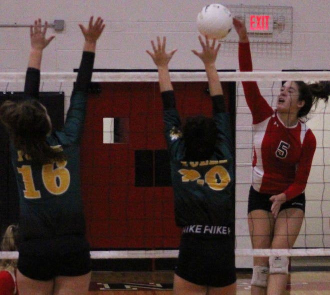 Bishop Kenny outside hitter Bailey Chin (5) spikes the ball for one of her 18 kills against Yulee.