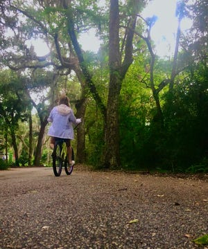 This photo of a rainy-day bike ride has earned honors in a statewide photo competition for Atlantic Beach Youth Council member Ava Rathet.