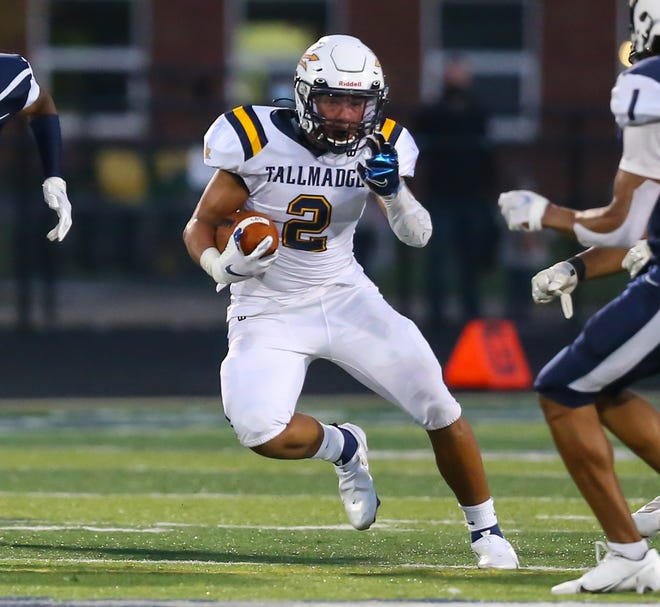 In this file photo, Tallmadge's Collin Dixon looks for running room during a game against Twinsburg.