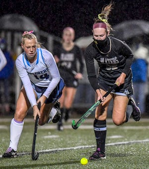 Hudson senior Marita Johnson brings the ball ahead during the Explorers' 9-0 win over Hathaway Brown Oct. 27 in a district semifinal game at Malson Field. Johnson had a hat trick in the first half.