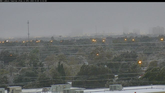 Ice and snow cover power lines and other surfaces across Central Lubbock Wednesday morning as a potent Arctic cold front brought wintry precipitation to the region.