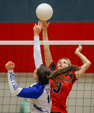 Victory Christian's Kaylie Whittenton shoots as she is challenged by Mount Dora Christian defender Leah Marshall during the Class 2A, Region 2 semifinal volleyball match.