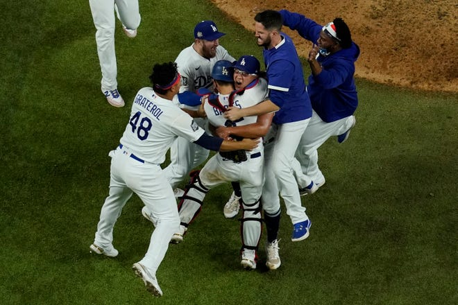 The Los Angeles Dodgers celebrate after defeating the Tampa Bay Rays 3-1 to win the World Series in Game 6  on Tuesday night in Arlington, Texas.