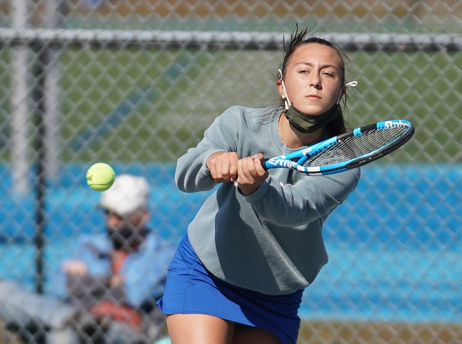 Chloe Christy's easy victory at No. 3 singles put Middletown on the way to a 6-1 triumph over Bay View.