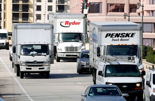 Trucks travel into Palm Beach over the Royal Park Bridge on Tuesday.  The town is considering a ban on trucks on some streets.