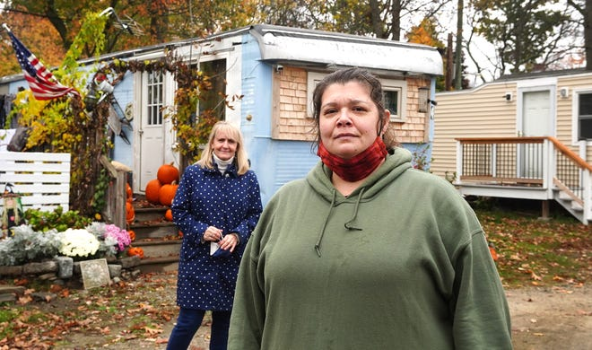Kathy Ireland, Woodbury Cooperative board secretary and resident, center, is joined by Tara Reardon, director of ROC-USA, as they walk around the former Ward's Park in Portsmouth that will undergo a neighborhood revitalization with help from the New Hampshire Community Loan Fund.