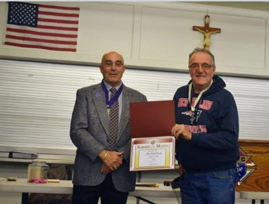 Grand Knight Terry Sylvanus, left, honors Ron Robichaud with the Knight of the Month award for October 2020.