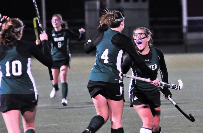 Dover's Jeannine Turgeon, right, celebrates with Jess Couture (4) after the Green Wave's 3-2 win over Concord in the Division I semifinals on Tuesday in Exeter.