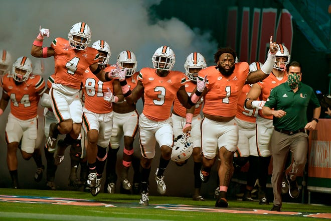 The Miami Hurricanes take the field to play the Virginia Cavaliers last Saturday. Miami, which is off this week, is 5-1 at the midway point of its ACC schedule.