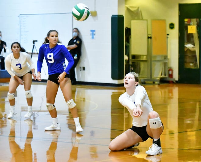 Lake Worth Christian outside hitter Kelly Franklin digs the ball during a playoff win win over Boca Raton Christian earlier this season.