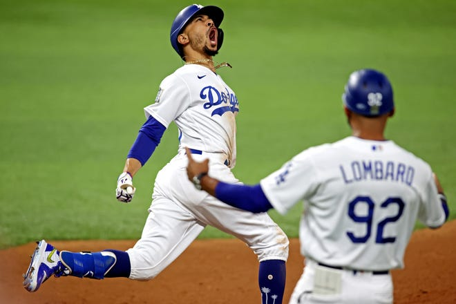 Dodgers right fielder Mookie Betts celebrates after hitting a home run during the eighth inning against the Tampa Bay Rays in Game 6 of the 2020 World Series at Globe Life Field