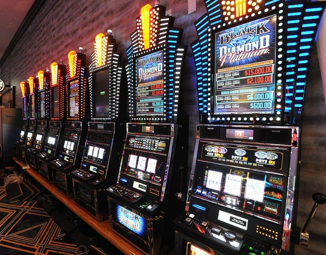 Slot machines line the walls at Twin River's Tiverton Casino Hotel in Tiverton.