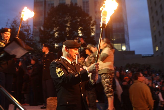 "Veterans take part in a torch procession from the State House to Waterplace Park during the 2015 WaterFire ""Salute to Veterans."" This year's video presentation will include highlights of previous ceremonies."
