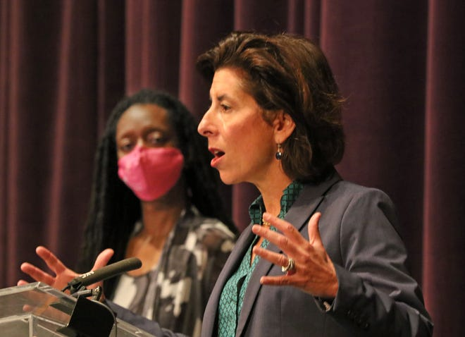 Gov. Gina Raimondo speaks Wednesday at Veterans Memorial Auditorium, as Health Director Dr. Nicole Alexander-Scott looks on.