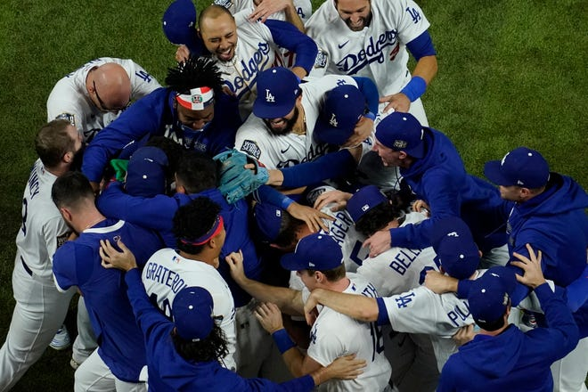 The Los Angeles Dodgers celebrate after winning the World Series championship with a 3-1 win Tuesday over the Tampa Bay Rays in Game 6 in Arlington, Texas.