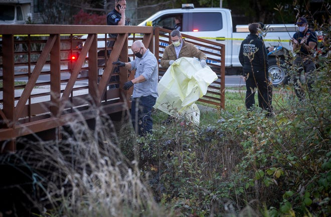 Eugene Police work at the scene where a deceased person was found under the bridge at East 39th Avenue and East Amazon Drive on Tuesday in Eugene.