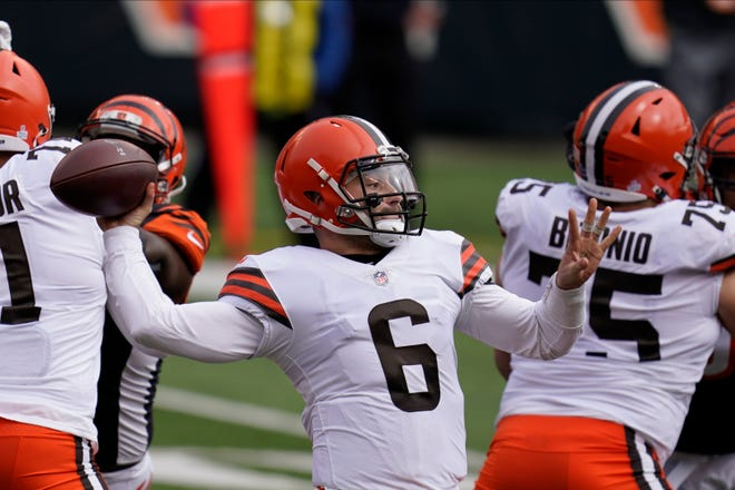 Cleveland Browns quarterback Baker Mayfield (6) throws before an NFL football game against the Cleveland Browns, Sunday, Oct. 25, 2020, in Cincinnati. (AP Photo/Michael Conroy)