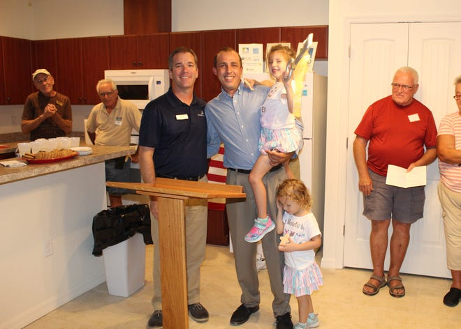 John Giglio of Freedom Boat Club hands the keys to new Habitat homeowner Jason in 2019.