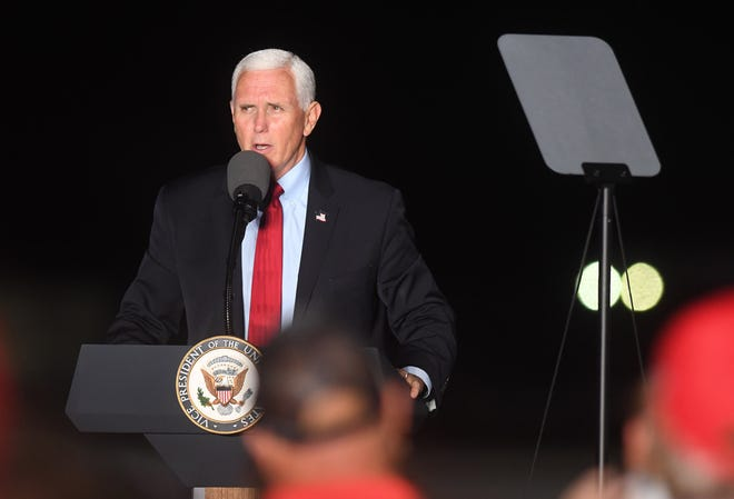 Vice President Mike Pence speaks during a campaign event at Wilmington International Airport in Wilmington, N.C., Tuesday, October 27, 2020. The event was his third of the day after  stops in Greensboro and Greenville, S.C.    [MATT BORN/STARNEWS]