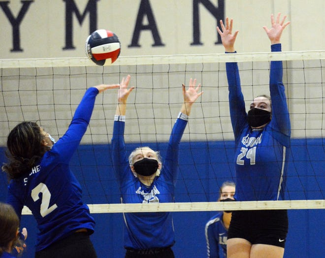 Lyman Memorial's April Beckwith, left, and Ani Rose Johnson try to block a return from Bacon Academy's Ava Sanchez  during their match earlier this season in Lebanon. See videos at NorwichBulletin.com