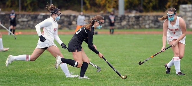 Marlboro's Amy Shanahan, center, tries to get past a pair of Hudson defenders in a game earlier this season.
