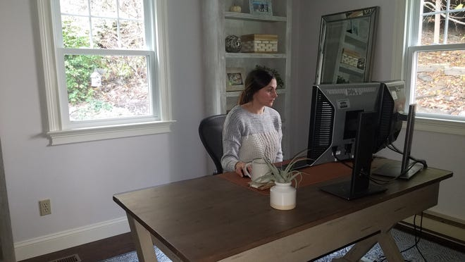 Jennie Petrie, director of employee communications at Unum, in her home office in Worcester.
