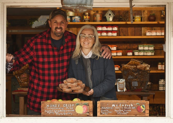 Red Apple Farm owners Al and Nancy Rose with a pile of their award-winning cider doughnuts  Oct. 20 in Phillipston. [T&G Staff/Rick Cinclair]